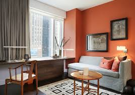 contemporary home office in new york with orange and subtle hints of black and gray
