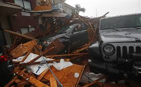 a storm chaser climbs into his vehicle as the eye of hurricane michael passed to retrieve equipment after a hotel canopy collapsed in panama city beach