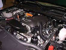 chevrolet silverado the engine compartment of a 2006 gmc sierra hybrid