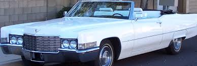 our 1969 cadillac convertible is a white leather with black piping beauty a custom bar in rear is one of the many great customizations to this classic car antique classic black