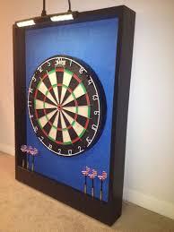 lighted ina blue black trim dart board cabinet w led cordless light