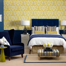 blue bedroom with yellow patterned wall