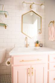 modern glam blush girls bathroom design gold hexagon mirror blush cabinets gold hardware white hexagon floor