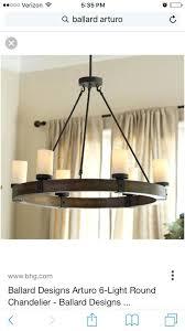 round chandelier over rectangular table