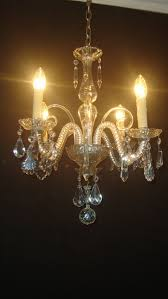 a venetian cut glass four light chandelier italy mid 20th century