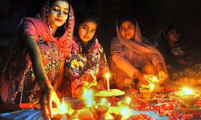 light love and prayers celebrating diwali in  hindu girls busy in their religious rituals during diwali festival in shiva mandir at thandi sarak