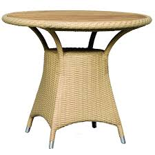 round synthetic rattan dining table with natural color