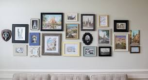 1. Travel gallery wall. Display art, photos or postcards ...