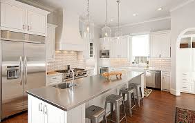 white kitchen with stainless steel island countertop photo source decoist com