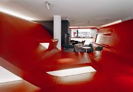 red and black furniture. futuristic red wall and black furniture in hotel lobby design d