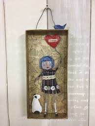 girl and dog paper mache wall art mixed