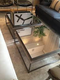 pair of square industrial mirrored coffee table with glass top and
