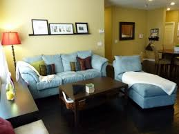 vintage home decorations light blue sofa bed dark finished wood table soft yellow walls dark