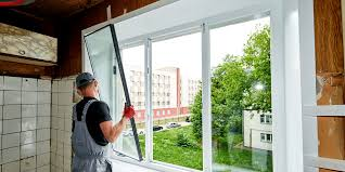 man replacing and fixing a window