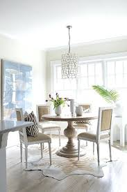 rug under kitchen table zebra cowhide design ideas dining nz