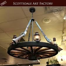 wagon wheel chandelier diy wagon wheel chandelier tiered how to make with mason jars