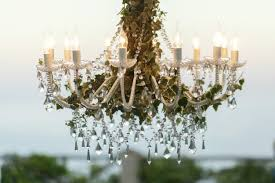 crystals hang from the chandelier decorated with greenery free photo