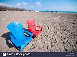 One of the many pairs of colourful Muskoka style chairs randomly placed on Kew  beach in