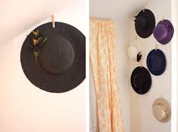 Hanging Hats Display made with clothespins and adhesive. Great idea! I  might paint the