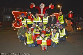 a group of bridlington round table volunteers and its santa sleigh was ed by yobs as