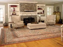 Living Room Laminate Floor Mixed With White Cabinet And Yellow