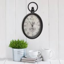 stratton home decor antique black oval wall clock s02198 the home depot