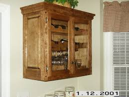 hanging wine cabinet and trash/recycling cabinet