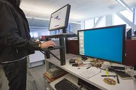 spend 20 bucks build yourself an adjule standing desk in 20 minutes pcworld