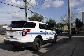 a new orleans police department vehicle sits outside