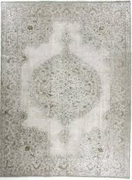 a hand carved old anatolian carpet is refreshed for today s consumer in the vintage 3 d fusion collection with metallic glitter on the pile