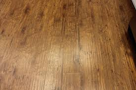 choosing between laminate and luxury vinyl plank flooring