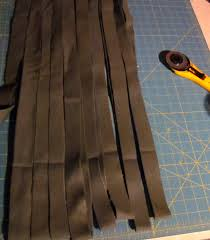 i fold the flat fabric up into multiple thicknesses and cut the width of strips i need for various rag rugs