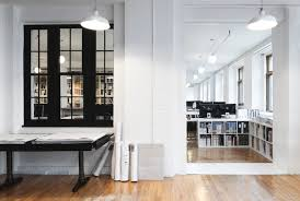 Courtesy urban office Nearly 100 The Offices Brick Walls Give An Interesting Texture And An Urban Atmosphere As The Interior Work Design Magazine Parka Architecture Designs Employeecentric Quebec City Offices