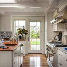 french doors in kitchen. Exellent French Stunning White Kitchen With French Doors For In T