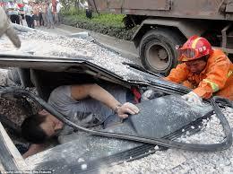 Driver survives horrific crash after truck FLATTENS his car | Daily ...