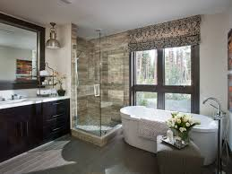 White Master Bathroom Illuminated With Chandelier Over Tub And - Recessed lights bathroom