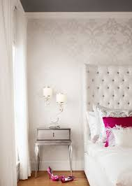 delicate patterned wallpaper adds dimension to this bedroom