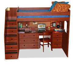 rich red wood tones inform this loft bed with a full size desk built in drawers on each side of the desk are complemented by ones built into the staircase bed desk set