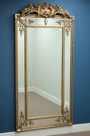 large rectangular wall mirror in ornate gilt cushion frame with pediment w92cm h184cm