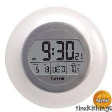 round digital wall clock temp day date
