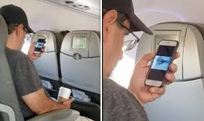 Uneasy passenger films man watching 9/11 footage moments ...