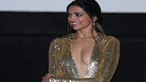 Deepika Padukone stuns in Plunging Golden Dress XXX Return of.
