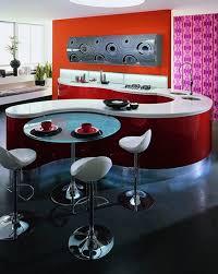red curved kitchen cabinet and pedestal round glass top bar table also chrome pedestal bar stools in modern minimalist kitchen design ideas