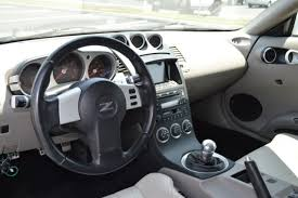 2004 nissan 350z interior. year2004 model nissan 350z touring edition engine 35 v6 trans 5 speed manual color white exterior tan interior mileage114977 2004 350z e