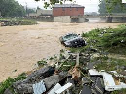 photo in this photo released by the the weather channel a vehicle rests on