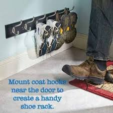 low mounted coat rack for entryway shoe storage