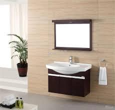 modern bathroom storage. Bathroom : Tasteful White Single Sink And Ceramic Tops Floating Vanities As Modern Mirror Cabinets On Soft Brown Graphic Wallpaper Storage