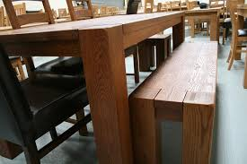 each of the boston tables comes with a size of bench to fit neatly between the legs of the table as shown above
