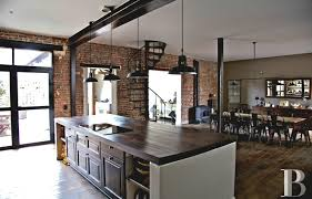 Industrial Kitchen Enchanting Industrial Kitchen With Marble Top Also Brick Wall