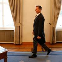 newly accredited u s ambador richard allen grenell walks to sign his letter of accreditation during a